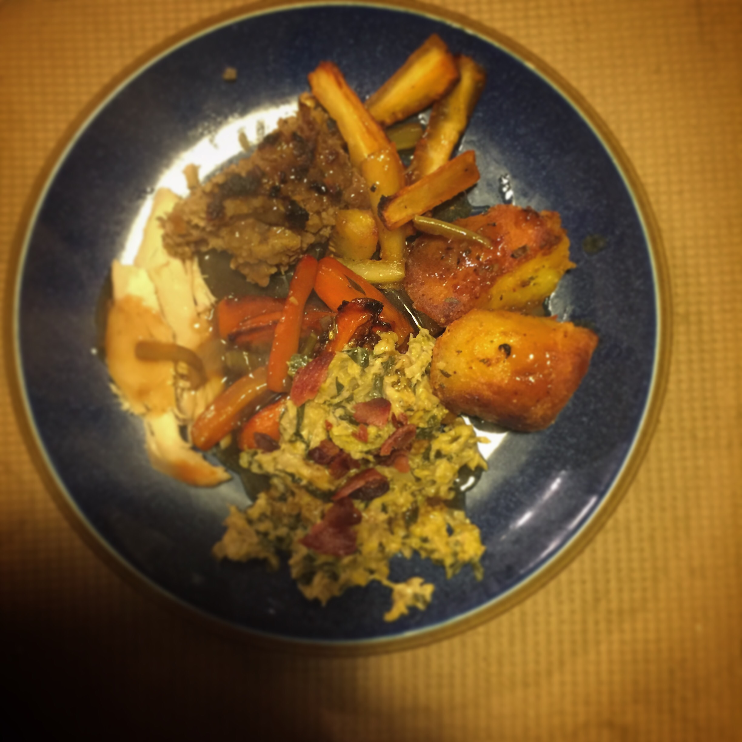a delicious roast dinner featuring the roasted carrots